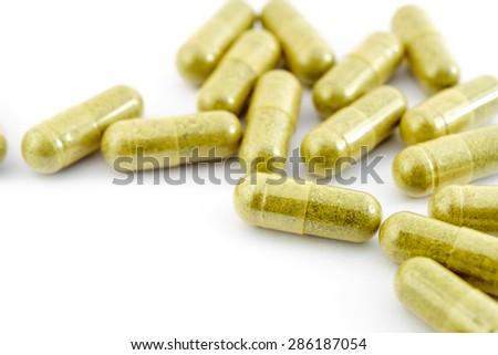 Herbal medicine capsules - stock photo