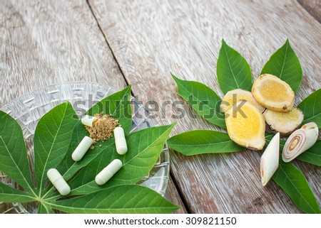 Herbal medicine in capsules from ginger and Bengal root  - stock photo
