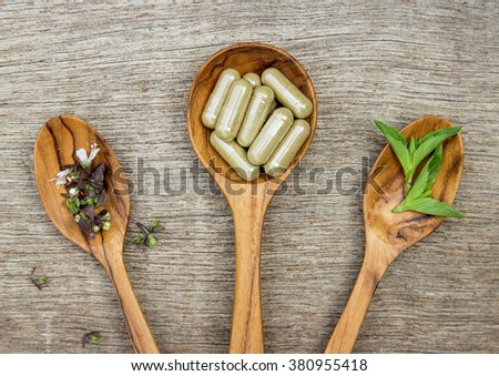 Herbal medicine in capsules from sweet basil. herbal for healthy living.  - stock photo