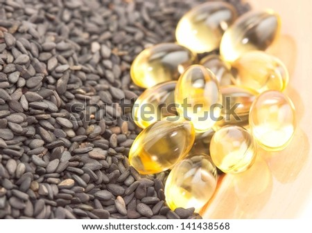 herbal medicine oil pills with Poppy seed - stock photo