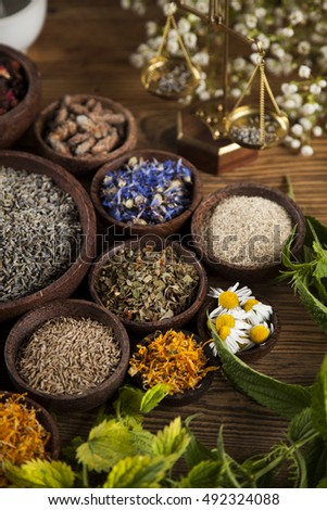 Herbal medicine on wooden desk background
