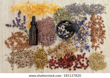 ... also used in magical potions over oak background. - stock photo