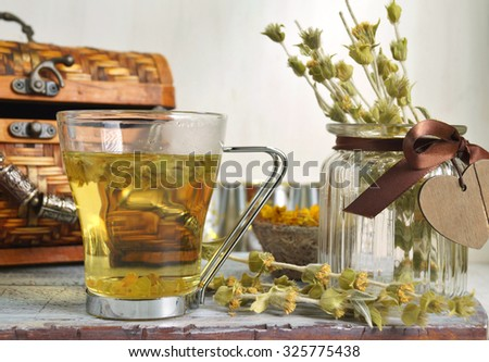 Herbal medicine - Sideritis perfoliata ( Lebanese sage) herbal tea and flowers on wooden background - stock photo
