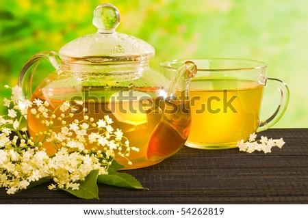 herbal medicine, tea with  elder flower - stock photo