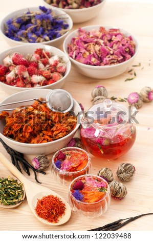 Herbal natural floral tea infusion with dry flowers ingredients - stock photo