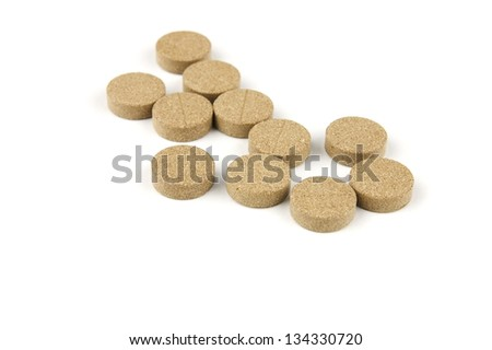 Herbal pills over white background