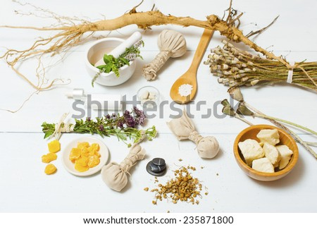 herbal plants, alternative therapy setting on white wooden table - stock photo