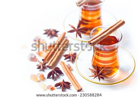 Herbal rosoes tea in turkish traditional tea glasses - stock photo