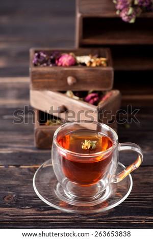 Herbal tea and dried herbs - stock photo