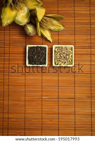 Herbal tea, green tea,  on straw background. Space below for inscription.