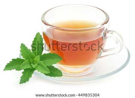 Herbal tea in a cup with stevia leaves over white background