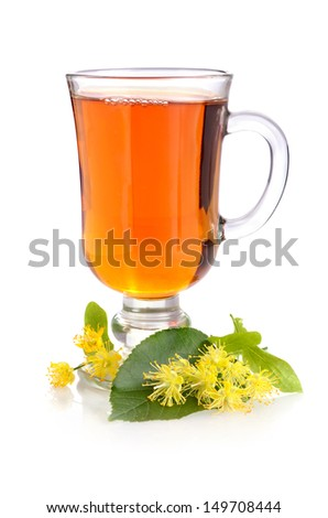 Herbal tea in cup with linden flowers on a white background