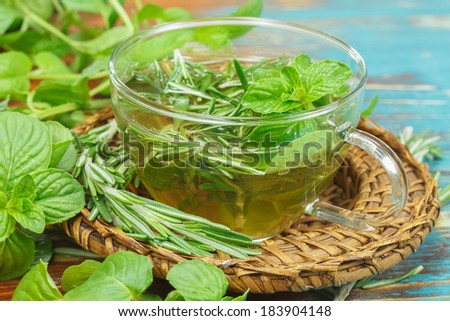 Herbal tea. Rosemary Mint Tea with fresh rosemary and mint leaves. Macro, selective focus - stock photo