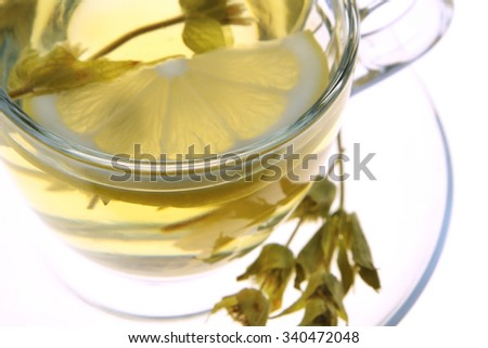 Herbal tea, sage leaves and lemon slice
