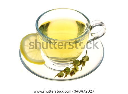 Herbal tea, sage leaves and lemon slice isolated on white background
