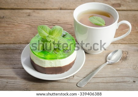 herbal tea with cake on wooden background.