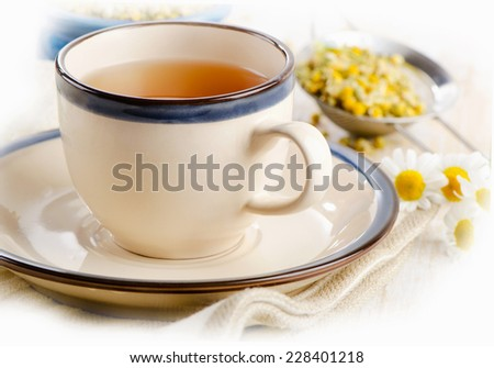 Herbal tea with chamomile flowers. Selective focus - stock photo