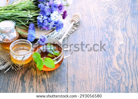 herbal tea with honey  - stock photo