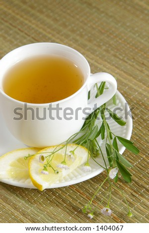Herbal tea with lemon. Good copy space. - stock photo
