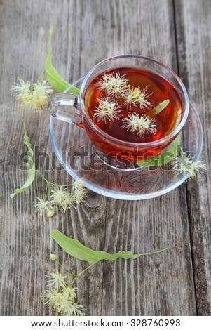 Herbal tea with linden on an old wooden table