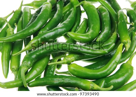 herbs : A pile of spicy green hot chili peppers over white background