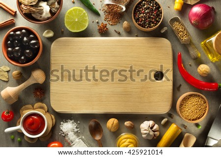 herbs and spices and wooden cutting board - stock photo