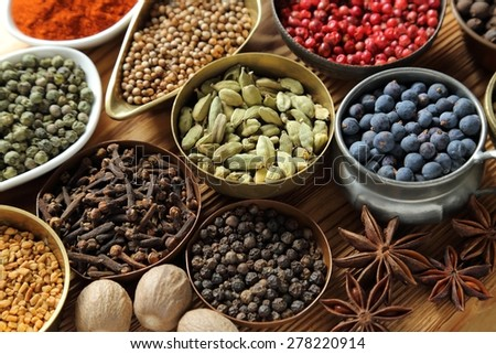 Herbs and spices composition. Cooking ingredients in a metal bowls. - stock photo