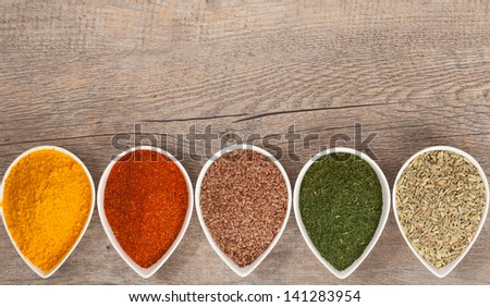 Herbs and Spices in a Row - stock photo