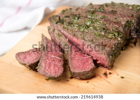 Herbs and Spices Marinated and Cooked to Medium Rare London Broil Steak - stock photo