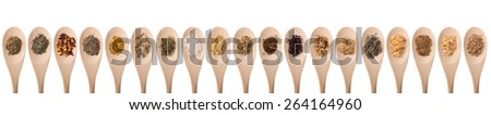 Herbs and spices on a wood spoon. Isolated, room for copy space - stock photo