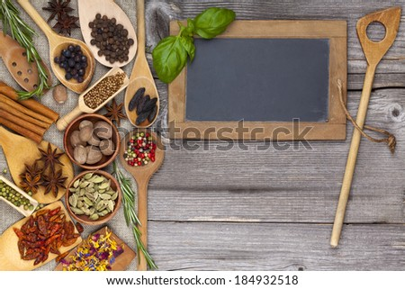 Herbs and spices on rustic wooden background - stock photo