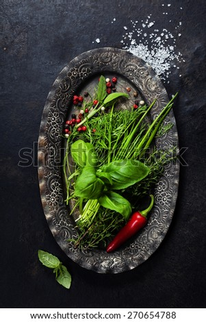 Herbs and Spices on vintage plate - stock photo