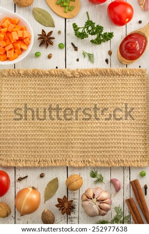 herbs and spices on wooden background - stock photo