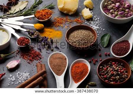 Herbs and spices over black stone background