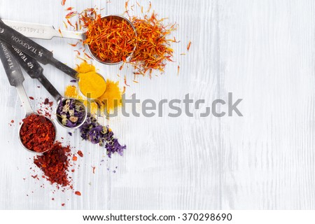 Herbs and spices over white wood background. Top view with copy space - stock photo
