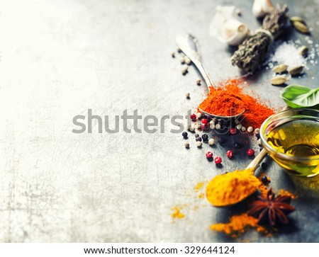 Herbs and spices selection on vintage background - stock photo