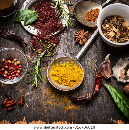 Herbs and spices selection with curry and staghorn sumac powder , close up