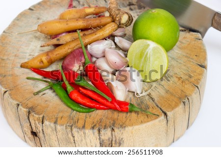 Herbs and spices set on the chopping block with knife to make spicy soup and fried delicious recipes, spicy ingredient in Thailand - stock photo