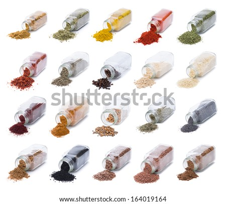 Herbs and spices spilling from spice jars isolated on white background   - stock photo
