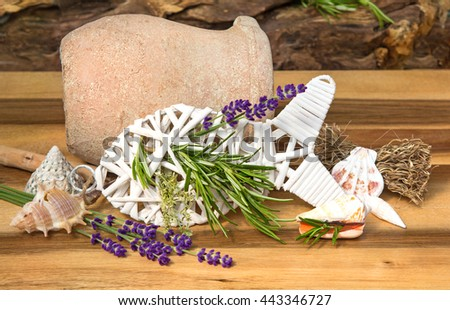 Herbs for fish dishes decorated on a wooden table.