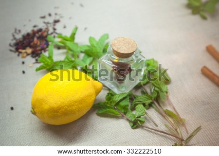 herbs for tea and a cinnamon on a linen background - stock photo