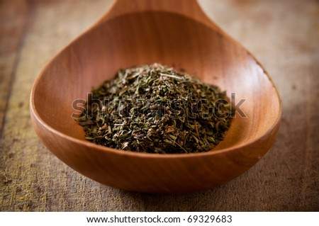 herbs in wooden spoon - stock photo
