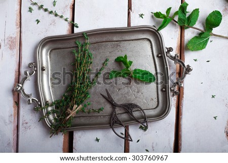 herbs thyme and mint on a tray. preparations for making tea