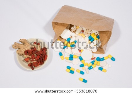 Herbs with alternative medicine herbal supplements and pills - stock photo
