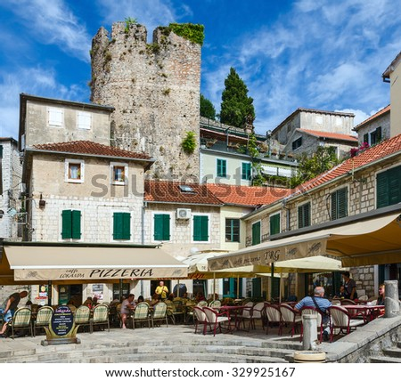 HERCEG NOVI, MONTENEGRO - SEPTEMBER 25, 2015: Unidentified tourists are relaxing in cafe-pizzeria on the square Nicolas Dzhurkovicha in the popular resort town of Herceg Novi, Montenegro