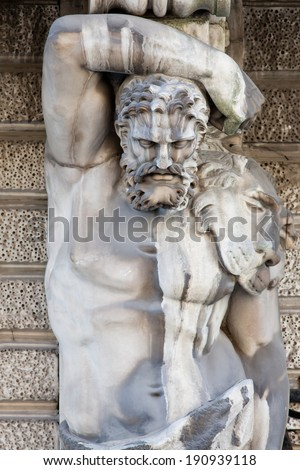 Hercules. Detail of the facade decoration mansion XVIII century. Influence of weather conditions on the architecture of St. Petersburg, Russia. - stock photo