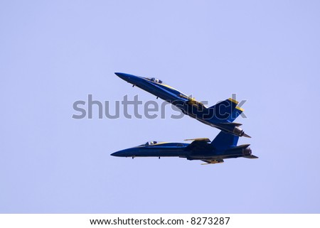 Here is a photo of two jet fighters performing a maneuver while flying at over 400 mph