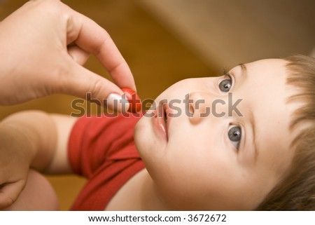 Here's a candy for you baby! - stock photo