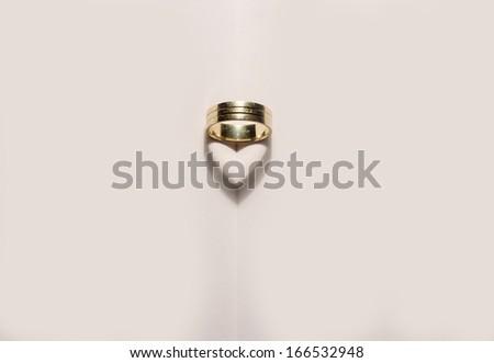 Heritage golden ring waiting to be worn at wedding - stock photo