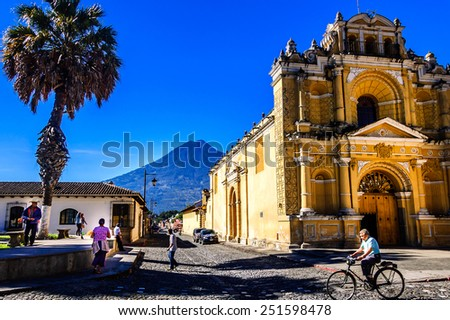 Hermano Pedro church, Antigua, Guatemala - Oct 5, 2014: Typical street scene in Spanish colonial town of Antigua. Agua volcano in the background. - stock photo